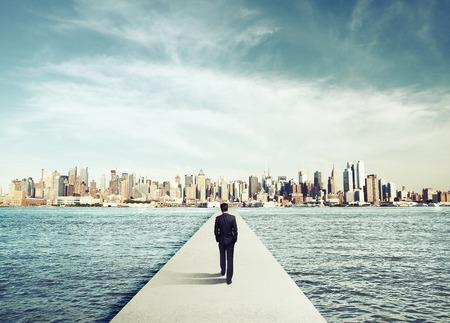 businessman in suit walking on concrete bridg to city