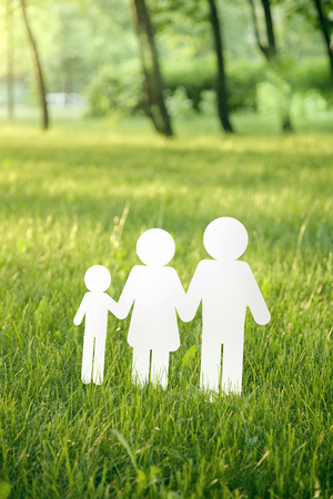 paper family on green grass