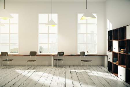 Photo pour White coworking office interior design with windows, lamps, dark wooden chairs, bookshelves and light wooden floor. 3D Render - image libre de droit
