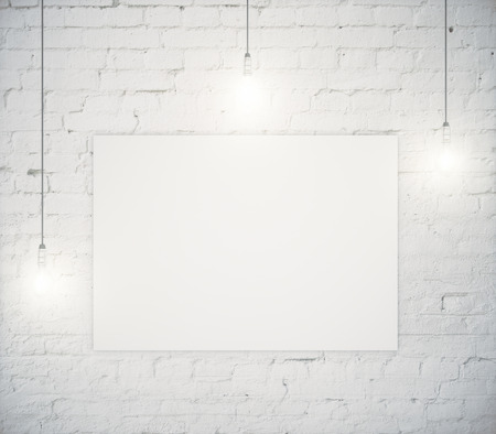 Foto de Blank poster hanging on a white brick wall with three light bulbs. Mock up, 3D Render - Imagen libre de derechos