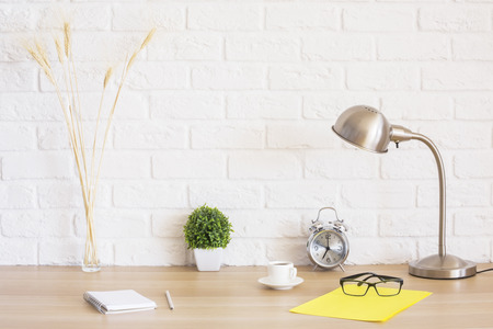 Photo for Creative desktop with glasses, alarm clock, notepad, coffee cup, wheat spikes and other items - Royalty Free Image