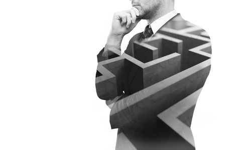 Photo pour Young businessperson thinking about ways to overcome business obstacle. Isolated on white background with maze and copy space. Double exposure - image libre de droit