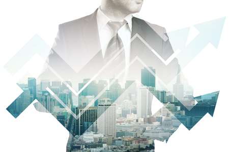 Businessman in suit and abstract business chart arrows on city background. Double exposure. Financial growth concept