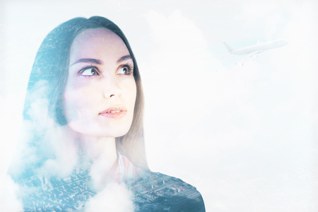 Photo pour Attractive young woman on abstract city background with plane, copy space and clouds. Girl thinking about holidays. Vacation concept. Double exposure - image libre de droit