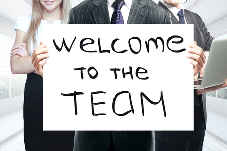 Photo for Businesspeople holding whiteboard with 'welcome to the team' text. Teamwork concept - Royalty Free Image