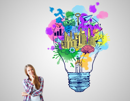 Photo pour Cheerful european woman with creative sketch on grey background. Business ideas concept - image libre de droit