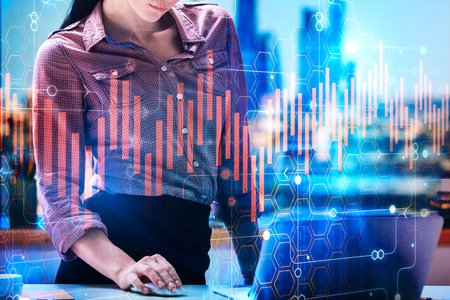 Foto de Businesswoman hands using laptop at modern office desktop with supplies and abstract city view. Accounting and profit concept. Double exposure  - Imagen libre de derechos