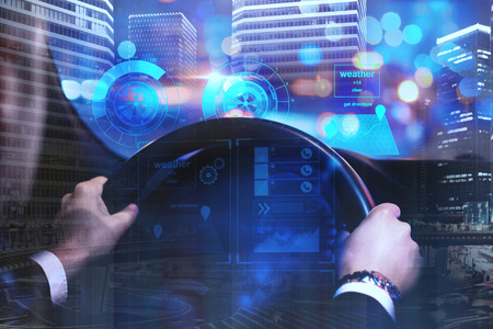 Foto de Businessman driving car with digital business interface on abstract night city background. Future and innovation concept. Double exposure  - Imagen libre de derechos