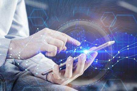 Foto de Hands using tablet with digital forex chart interface hologram. Technology, money and banking concept. Double exposure  - Imagen libre de derechos