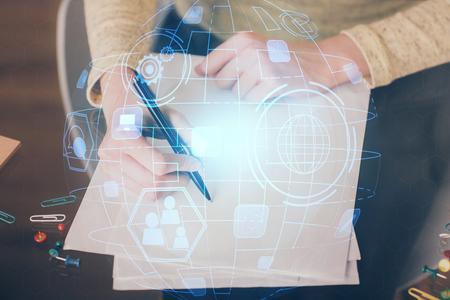 Photo pour Social network theme hologram over hands taking notes - image libre de droit