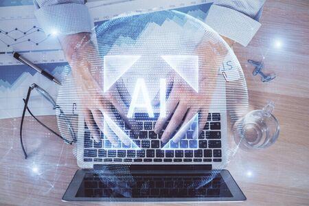 Photo pour Businessman with computer background with technology theme hologram. Concept of big data. Double exposure. - image libre de droit