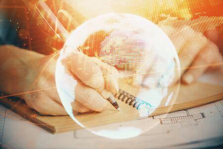 Photo pour International business hologram over womans hands taking notes background. Concept of success. Double exposure - image libre de droit