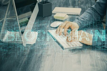 Photo pour Blockchain theme hud with businessman working on computer on background. Concept of crypto chain. Multi exposure. - image libre de droit
