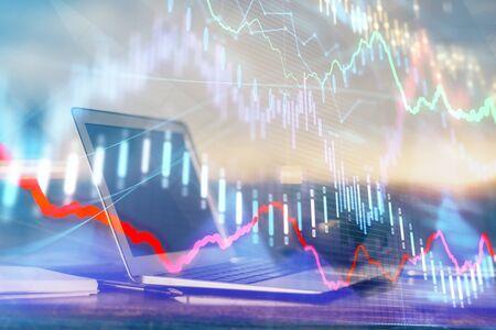Photo pour Forex market graph hologram and personal computer on background. Multi exposure. Concept of investment. - image libre de droit