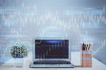 Foto de Multi exposure of forex chart and work space with computer. Concept of international online trading. - Imagen libre de derechos