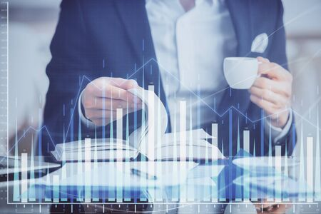 Photo pour Double exposure of businessman with coffee with stock market forex chart. - image libre de droit