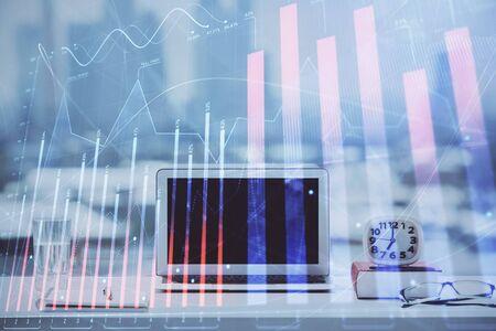 Photo pour Forex graph hologram on table with computer background. Multi exposure. Concept of financial markets. - image libre de droit