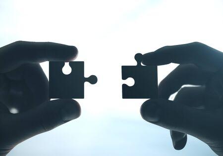 Photo pour Hands putting puzzle pieces together. Close up. Business and challenge concept. - image libre de droit