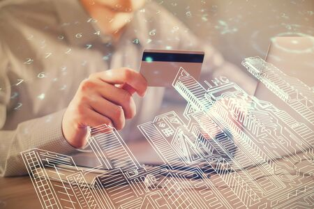 Photo for Double exposure of man hands holding a credit card and city drawing. modern town and E-commerce pay on-line concept. - Royalty Free Image