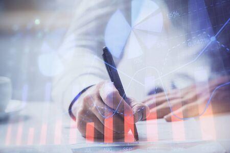 Photo pour Financial trading graph multi exposure with man desktop background. Concept of success. - image libre de droit