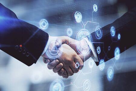 Photo pour Double exposure of data theme hologram and handshake of two men. Partnership in IT industry concept. - image libre de droit
