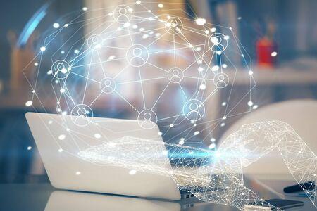 Photo pour Computer on desktop with social network theme icon. Multi exposure. Concept of international connections. - image libre de droit
