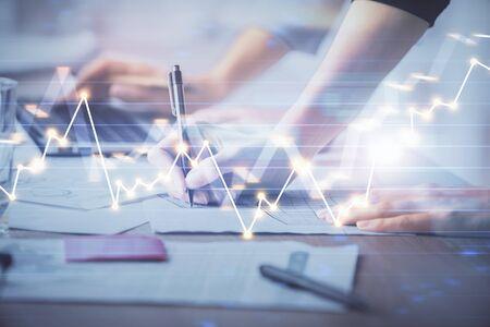 Foto de Multi exposure of woman hands typing on computer and financial chart hologram drawing. Stock market analysis concept. - Imagen libre de derechos