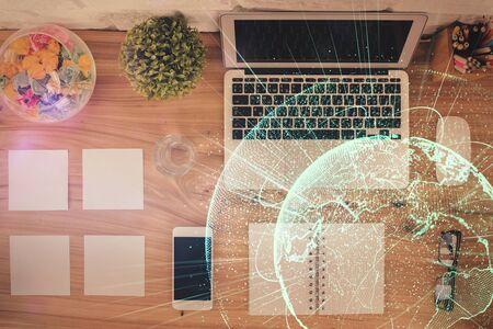 Photo pour Social network hologram drawings over computer on the desktop background. Top view. Double exposure. - image libre de droit
