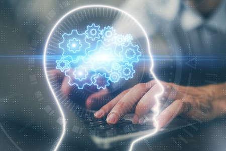 Photo pour Businessman with computer background with brain theme hologram. Concept of brainstorm. Multi exposure. - image libre de droit