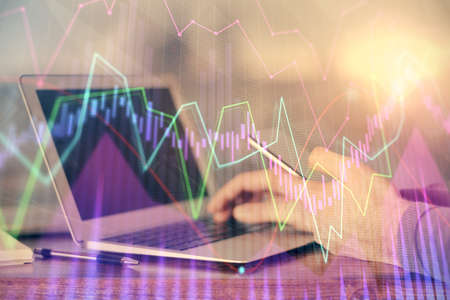 Photo pour Double exposure of man's hands holding and using a digital device and forex graph drawing. Financial market concept. - image libre de droit