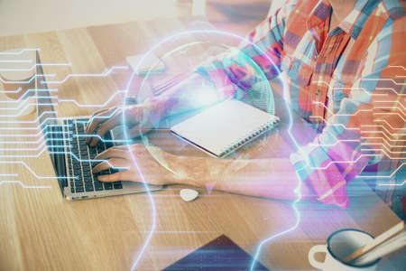 Photo pour Man typing on keyboard background with brain hologram. Concept of big Data. - image libre de droit