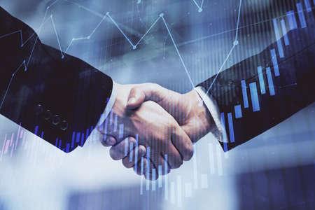 Photo pour Double exposure of forex graph hologram and handshake of two men. Stock market concept. - image libre de droit