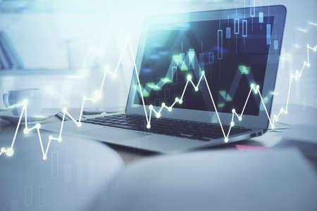 Foto de Forex graph hologram on table with computer background. Multi exposure. Concept of financial markets. - Imagen libre de derechos