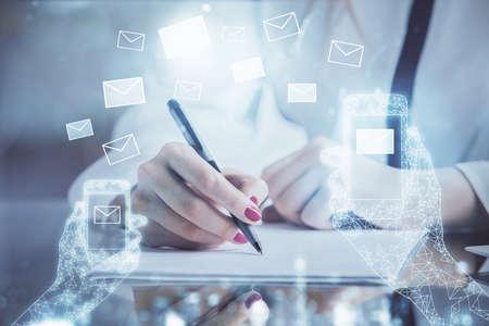 Photo pour E-mail envelop theme hologram over hands taking notes background. Concept of electronic mail. Double exposure - image libre de droit