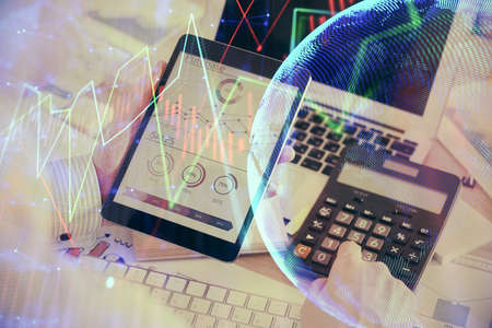 Photo for Double exposure of man's hands holding and using a digital device and forex graph drawing. Financial market concept. - Royalty Free Image