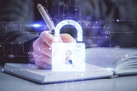 Photo pour Double exposure of hands making notes with lock icons. Concept security and protection of data - image libre de droit