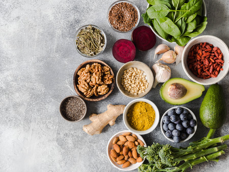 Photo pour Healthy clean food - vegetables, fruits, nuts, superfoods on a gray background. Healthy eating concept. - image libre de droit