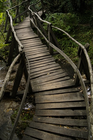 Winding wooden bridge over a river