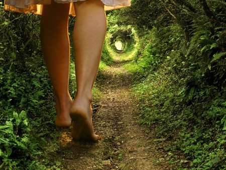 Photo for A collage of two images showing giant female legs walking onto a tunnel-like forest path with light at the end      - Royalty Free Image