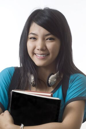 Young Attractive Female Asian Student Holding Her School