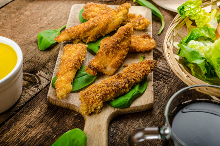 Corn crusted Chicken Tenders with spinach and toast, honey-dijon mustard dip, homemade bread baguette