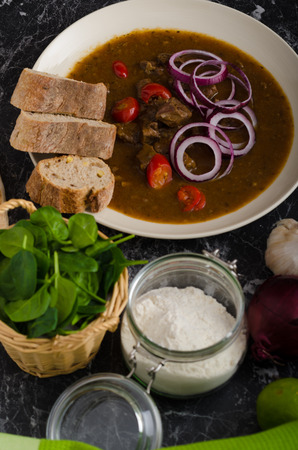 Original Czech beef goulash, red onion, hot chilli peppers in and bio healthy wholemeal bread
