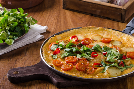 Frittata with tomatoes, herbs and chilli, little lettuce inside, very simple but delicious food