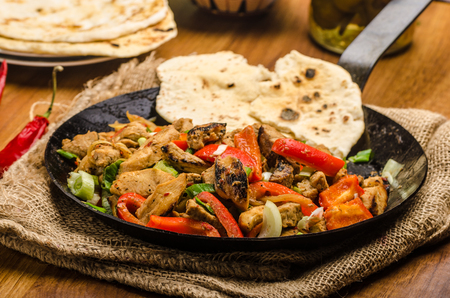 Sichuan meat mix with vegetables and homemade naan bread