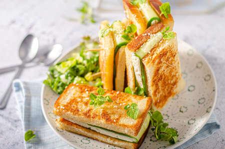 Foto de Simple but delicious heathy bread with goat cheese and cucumber - Imagen libre de derechos