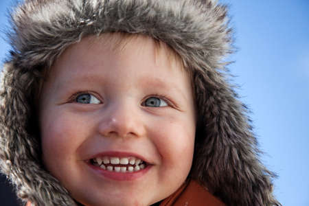 Photo pour Umea, Norrland Sweden - April 6, 2020: a happy boy in fur cap - image libre de droit