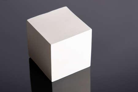 Photo pour The Cube is a geometric figure, a white figure on a black background. Cube 3D. - image libre de droit