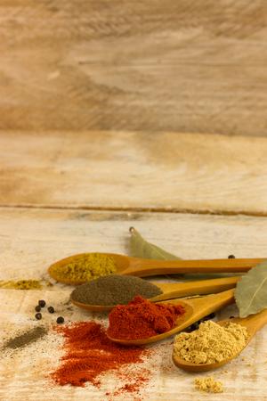 Photo pour various spice in wooden spoons - image libre de droit