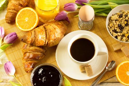 Photo pour breakfast table with coffee, croissants, muesli, orange juice - image libre de droit