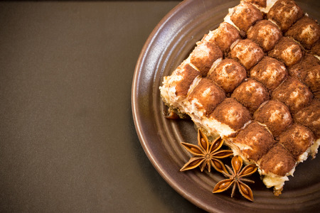 Photo pour tiramisu dessert creme over a black background - image libre de droit